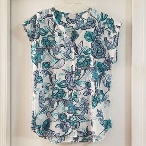 Sleeveless turquoise floral print blouse
